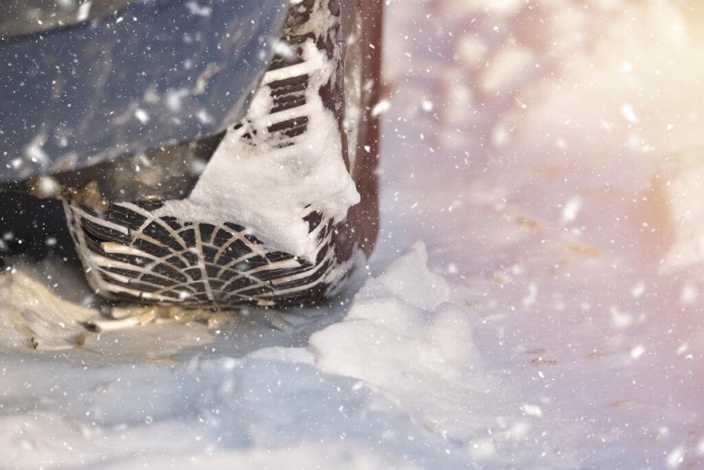 Car tire on snow
