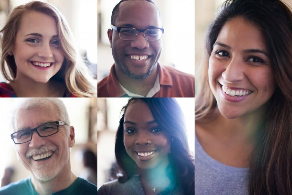 Five people smiling in separate screens