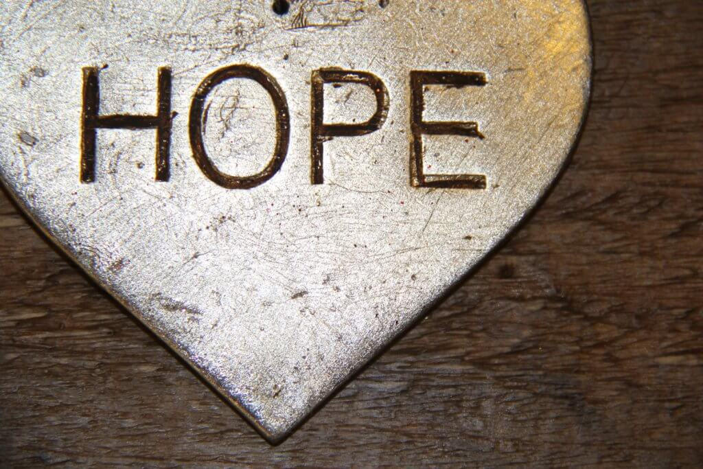 Charm with hope written on it