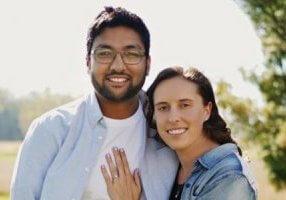 A couple posing outdoors